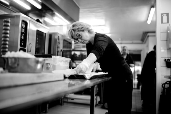 A female chef working in a commercial kitchen